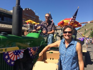 Board President Sloane Bergien Andrews and Anders Rae in the Annual 4th of July Parade in Downtown Jackson